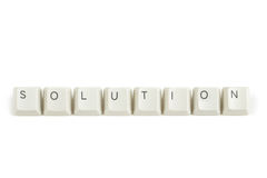 Solution from scattered keyboard keys on white. Solution text from scattered keyboard keys isolated on white background royalty free stock photo