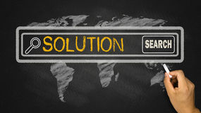 Solution in search bar. On blackboard Stock Photos