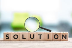 Solution search sign with wooden cubes Stock Photography