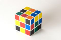 The Rubik`s cube on the white background. The solution sequence stage one. The object is isolated on white and a clipping path is provided for easy extraction Royalty Free Stock Photos