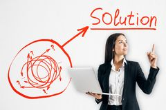 Solution and success concept. Attractive young businesswoman with drawing arrow doodle on white background stock photo