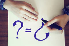 Solution to the problems.Question mark and hands.Photo toned Royalty Free Stock Images