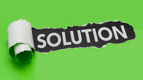 Solution. Torn green paper revealing the word Solution Stock Photo