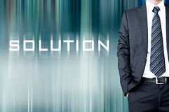 SOLUTION word on blur abstract background with businessman. SOLUTION word on motion blur abstract background with standing businessman Stock Photography