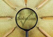 Solution. Word Solution under magnifying glass on vintage background Stock Photos
