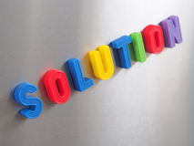 Solution. The word solution written with colorful magnetic letters Royalty Free Stock Photo