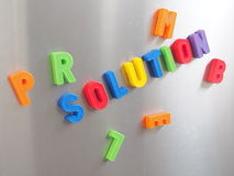 Solution. The word solution written with colorful magnetic letters. steel background Royalty Free Stock Images
