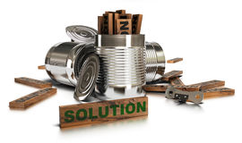 Solutions. Word solution written onto a wooden piece with many opened tins over a white background Royalty Free Stock Photography