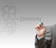 Solutions. Business hand draws teamwork solutions as concept Royalty Free Stock Photos