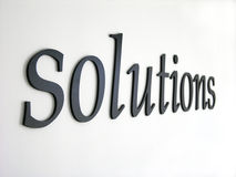 Solutions. Embossed letters forming the word solutions. Denim texture visible when viewed at full Royalty Free Stock Image