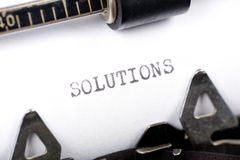 Solutions. Typewriter close up shot, concept of Solutions Royalty Free Stock Image