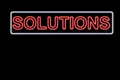 Solutions. Neon Solutions sign Stock Photography