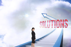 Solutions against red staircase arrow pointing up against sky Royalty Free Stock Images