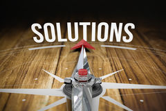 Solutions against wooden table Royalty Free Stock Image