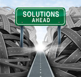 Solutions Ahead. And business answers concept with a green highway sign as an icon of breaking out from a confusion of tangled roads with a clear strategic path Stock Images