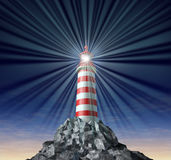 Solutions with a beaming Lighthouse symbol. Beaming light from a lighthouse on a rock mountain and strategic guidance as a symbol for solutions and answers with Royalty Free Stock Photos