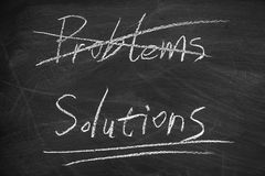 Solutions. On the blackboard with chalk writing Stock Photography