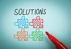 Solutions. Is on blue paper with a red marker aside Royalty Free Stock Photography