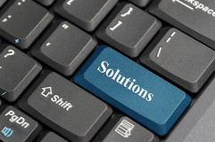 Solutions on keyboard. Keyboard with blue button, spelling solutions Stock Image