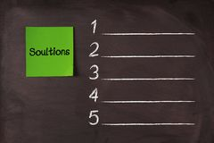 Solutions List. 'Solutions' note pasted on blackboard which can be background for your solutions list Royalty Free Stock Photography