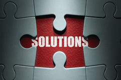 Solutions. Missing piece from a jigsaw puzzle uncovering solutions Stock Photography