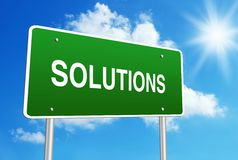 Solutions road sign. With blue shiny sky background Stock Images