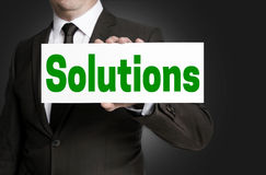 Solutions sign is held by businessman Stock Images