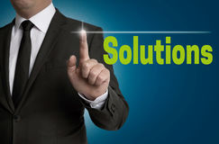 Solutions touchscreen is operated by businessman. Stock Photo