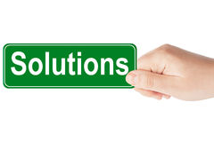 Solutions traffic sign in the hand Royalty Free Stock Photography