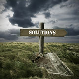 Solutions. Wooden sign with the word solutions in the field with ruins Royalty Free Stock Photo