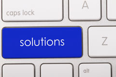 Solutions word on keyboard. Solutions word written on computer keyboard Royalty Free Stock Image