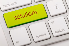 Solutions word on keyboard. Solutions word written on computer keyboard Royalty Free Stock Images