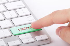 Solutions word on keyboard. Solutions word written on computer keyboard Royalty Free Stock Photo