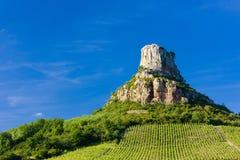 Solutre Felsen mit Weinbergen Stockbild