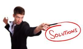 Soluzioni dell'illustrazione dell'uomo d'affari sul whiteboard Fotografie Stock Libere da Diritti