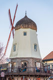 Solvang, USA - February 13, 2016: Lost Point winery and tasting room in a Danish style windmill in California with people eating Royalty Free Stock Photography