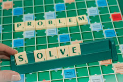 Solve the problem. Scrabble letters on the game field saying solve the problem Stock Image