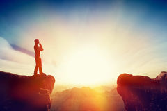 Solve the problem, think about solution, challenge concept. Solving the problem, thinking about solution, challenge concept. Man standing on mountain think Stock Photo