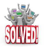 Solved People Cheering Solution Answer Plan Goal Achieved. A team of cheering people with the words Answer, Solution, Success, Plan, Complete and Idea behind the Royalty Free Stock Image