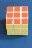 Solved rubic cube on blue background Stock Images