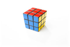Solved Rubik's Cube. KIEV, UKRAINE - DECEMBER 25, 2014: Rubik's cube on the white background. Rubik's Cube on a white background. Rubik's Cube invented by a stock image