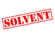 SOLVENT. Red Rubber Stamp over a white background Stock Photography