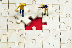 Solving a business puzzle Stock Photography