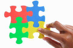 Solving colorful puzzle Stock Photography