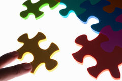 Solving colorful puzzle Stock Images
