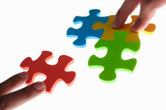 Solving colorful puzzle Royalty Free Stock Images