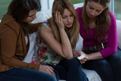 Solving a difficult problem. Three girl friends trying to solve a difficult pregnancy problem Royalty Free Stock Image