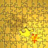 Solving the golden puzzle. The last piece of the puzzle flies into place Royalty Free Stock Images