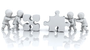 Solving jigsaw puzzle Stock Image