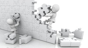 Solving jigsaw puzzle Royalty Free Stock Images
